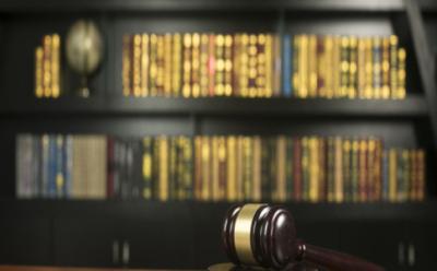 民法典对金钱之债给付货币的确定规则的规定